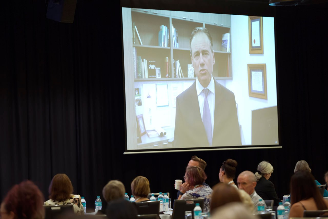 Image of Minister for Health on screen